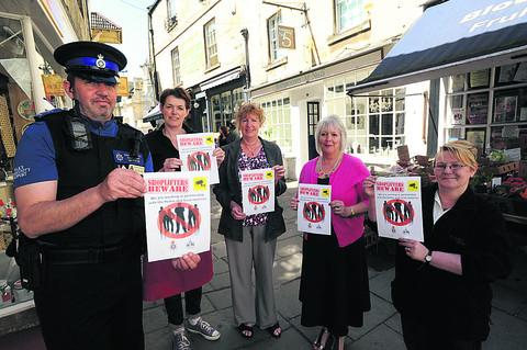 PCSO Joe Leeds with Shop Watch supporters Ruth Warren of Fetch,town clerk Diana Holmes,Geraldine Burrell of Elise and Val Steele of Budgens
