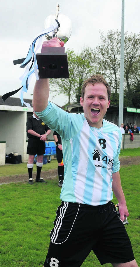 Biddestone Social captain Danny Jones lifts the Subsidiary Cup to complete his side's historic quadruple last season