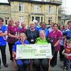 Asda's Nicky Phillips hands over a cheque for £200 to the fundraising campaign at Trowbridge Birthing Centre to Sylvia Howard and Beryl Orchard