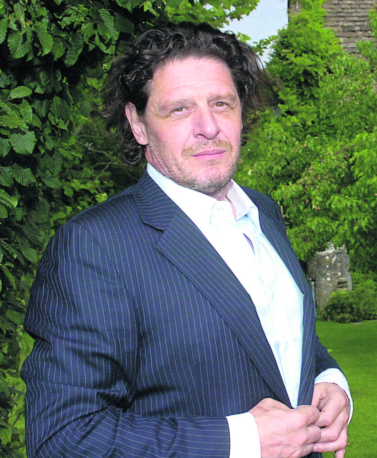 Marco Pierre White pictured in the grounds of the Pear Tree Inn by Trevor Porter