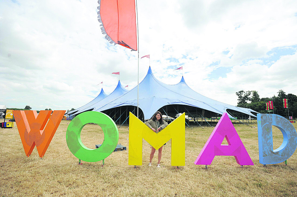 WOMAD worker Nichola Lamb has a break as the festival takes shape on Wednesday