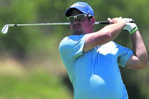 GOLF: Winds blow a hole Surry's fine day