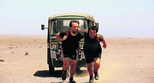 Richard Sears and Nick Gough pull their tuk tuk over the last section of their record-breaking journey around the world