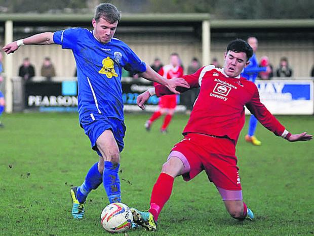 Frome Town's Rhys Baggridge (right) challenges Chippenham Town's Joe McClennan on Boxing Day