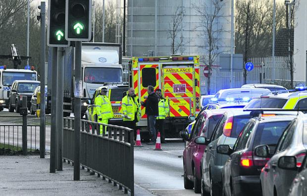 Police and an ambulance crew at the scene of the accident