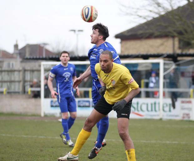 Chippenham Town's Jack Allward (blue) returned to training this week