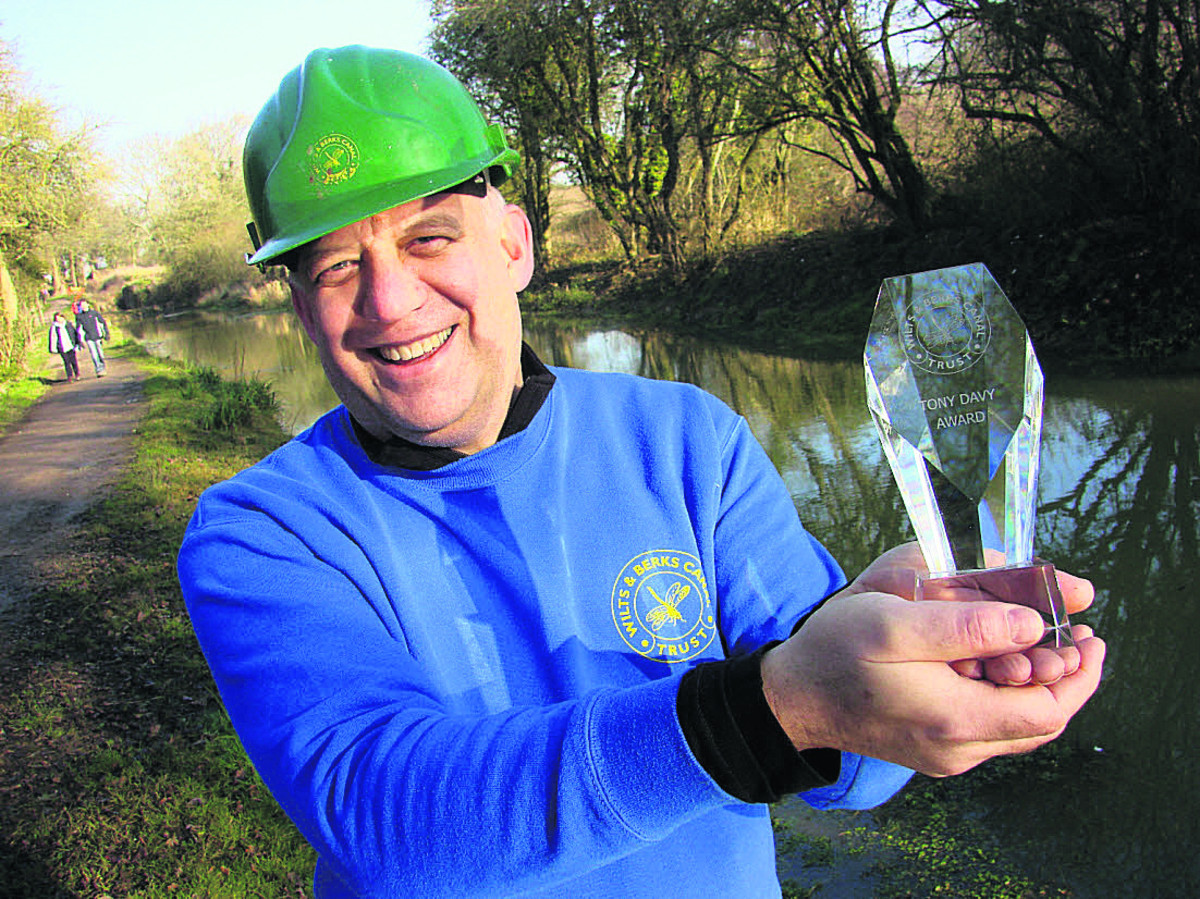 Branch chairman Derek Flexer holds aloft the Wilts and Berks Canal Trust's Tony Davy Award