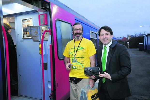 Rail campaigner Graham Ellis, left, with MP Duncan Hames at the launch of the expanded TransWilts service on December 9