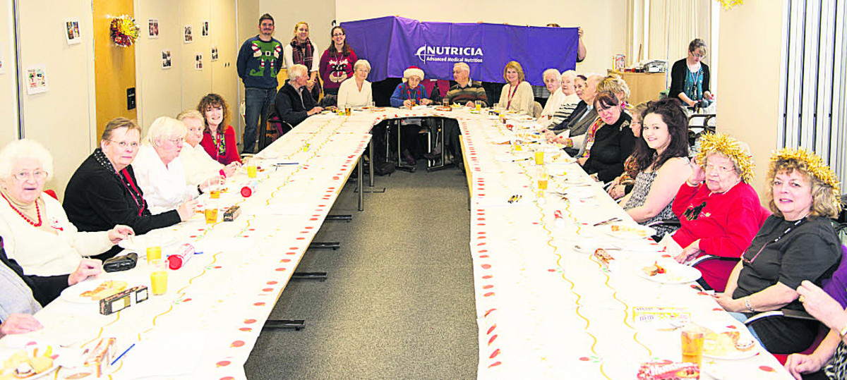 People with dementia and their carers at a party organised by volunteers from medical nutrition company Nutricia