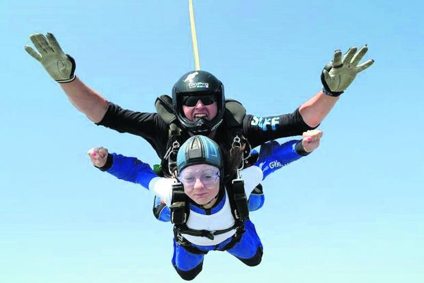 Instructor Ed Bowyer with a skydiving supporter of the air ambulance