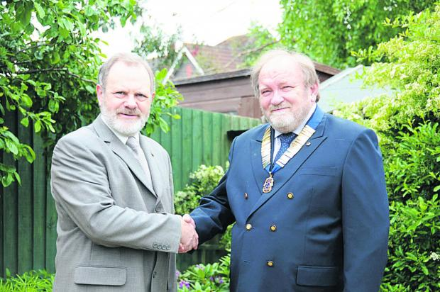 Trowbridge Lions have elected Graeme Dunn as their president for 2014. He is pictured  receiving the chain of office from outgoing president Robert Foubister.