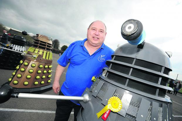 Ady Davies, founder of the annual sci-fi fair in Calne, with Daleks