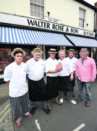 Phillip Jefferys, Andrew Cook, Andrew Cunliff and Stephen Cook outside Walter Rose Butchers