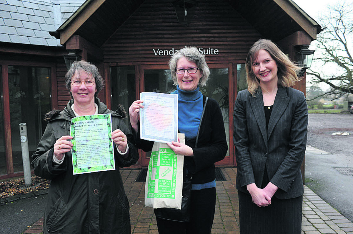 Climate Friendly Bradford on Avon's Ros Edwards and Sue Thomson get set for the show at Leigh Park, with the help of hotel events manager Louise Rathband