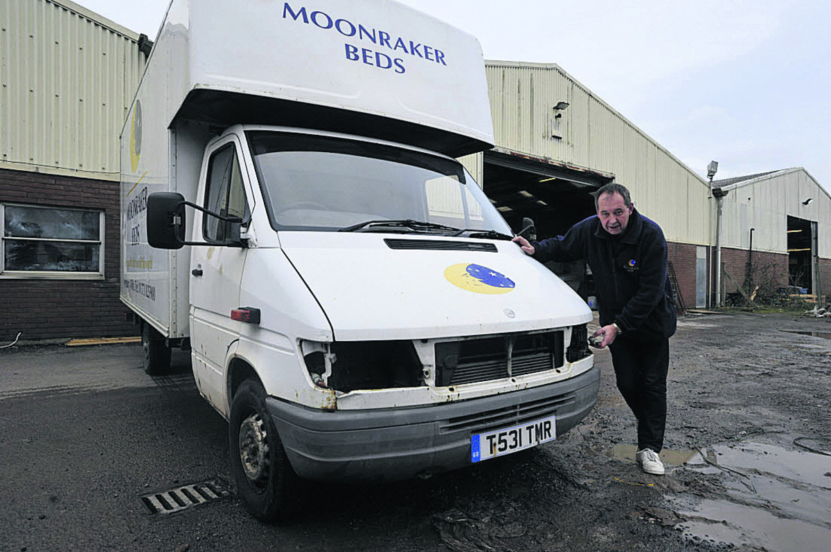 Moonraker Beds sales director Andy Lewis surveys damage to the pillaged truck