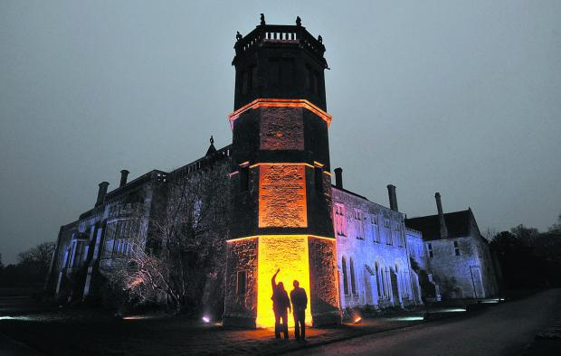 Wiltshire Times: Visitors admire illuminated Lacock Abbey last year