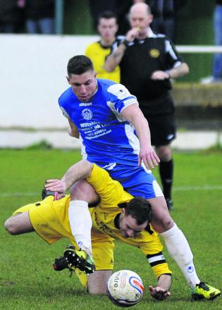 Pewsey captain Ryan Banks (above) hits the deck as he challenges Bradford's Jake Hiscocks last weekend