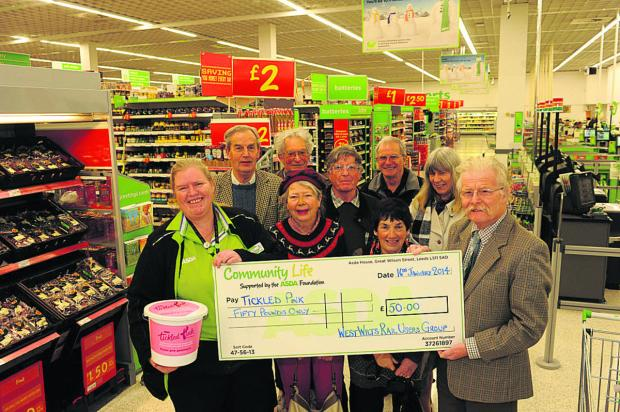 Nicky Philips of ASDA receives a cheque from West Wiltshire Rail Users Group chairman Roger Newman and members Janet Repton, Rosie Buchan, David Walden, Michael Balfe, Chris Wilding, Horace Prickett and Carrie White