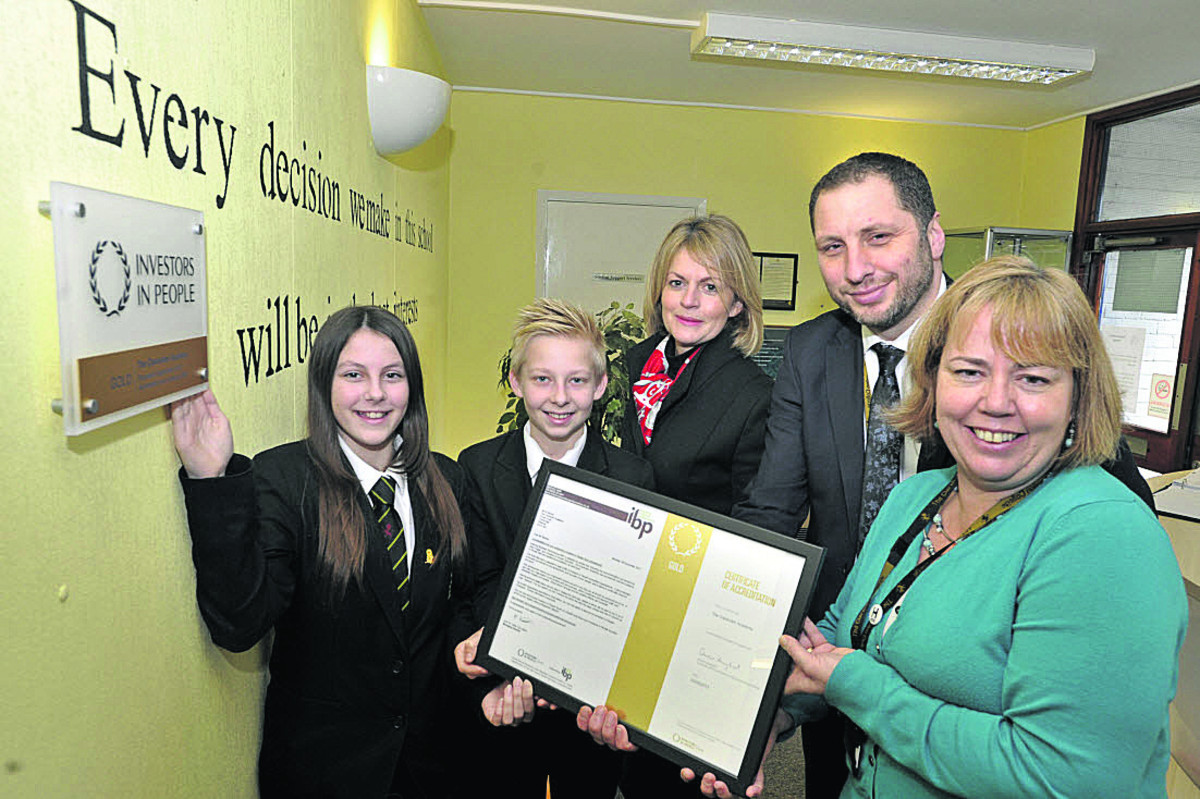 Clarendon Academy principal Mark Stenton, assistant principal Harriet Clarkson, right, chairman of governors Lizzie Rowe and pupil representatives Victoria Burden and Joe Rendle