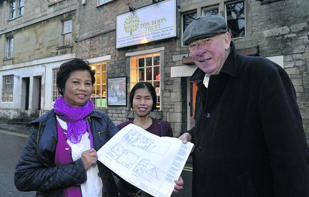 Saisunee and Alan Pettitt with Joy Richards, centre, outside the former Orient Express restaurant in Bridge Street, now cleared to become a Buddhist temple