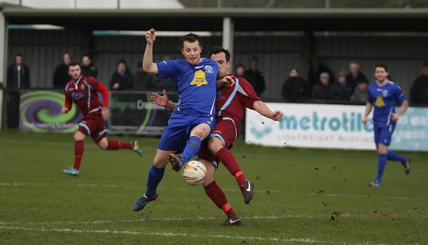 Chippenham Town's Callum Wright battles for the ball in last weekend's 2-1 win over Weymouth