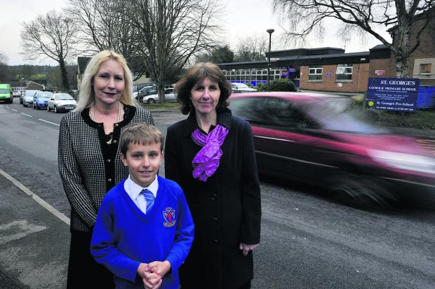 Headteacher of St George's, Louise Croker, left, with Rachael Cox and her son Josh who are campaigning for a zebra crossing outside the school