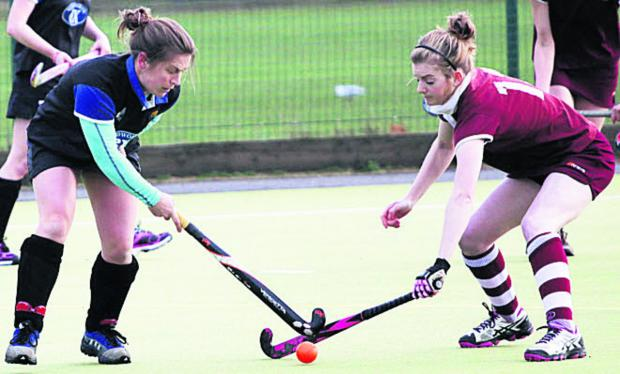 Jennie Holloway and Melksham Ladies' Katherine Robinson (right) battles with Devizes' Jennie Holloway during Saturday's West Clubs League Wessex Division One cl