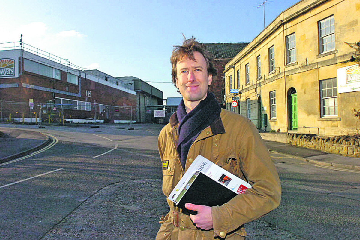 delighted Angus Horner from Prorsus stands outside the old Bowyers factory, which his company can now develop