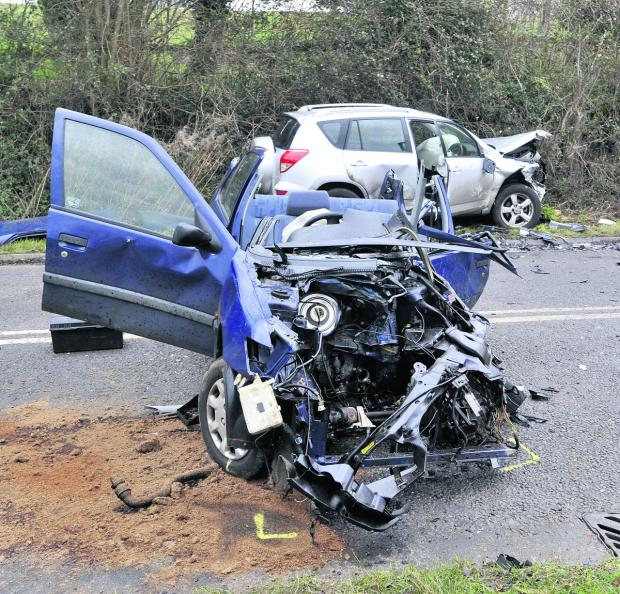 Wiltshire Times: A woman was trapped after this accident on Sandridge Hill this morning
