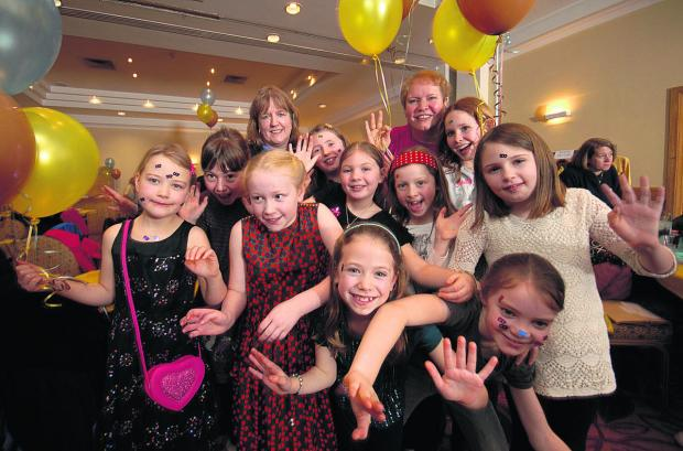 Wiltshire Times: Members of the 1st Minety Brownies enjoy the centenary party. Picture by Russell Sach