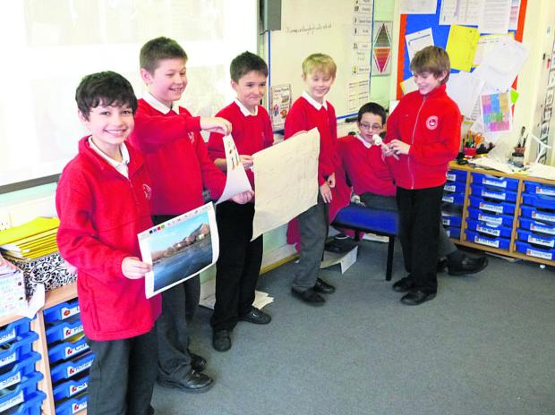 Westbury Leigh pupils with some of their work for Enterprise Day