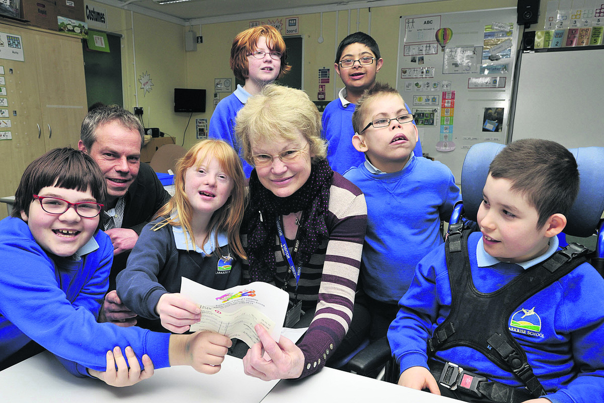 Trowbridge Carnival chairman Maryrose Mantle at Larkrise School with headteacher Phil Cook and pupils in Woodpecker class