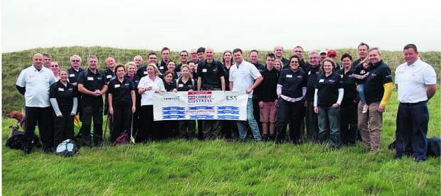 Wiltshire Times: Tim Shapland, front row centre in dark shirt, with fellow Longstrider volunteers who have helped him raise over £20,000 for the Combat Stress charity