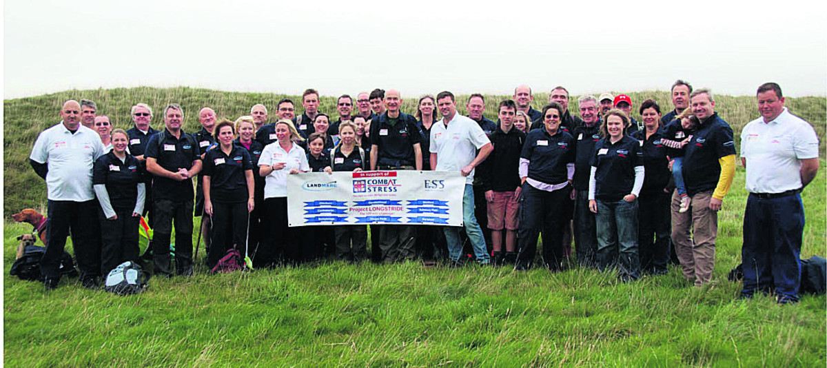 Tim Shapland, front row centre in dark shirt, with fellow Longstrider volunteers who have helped him raise over £20,000 for the Combat Stress charity