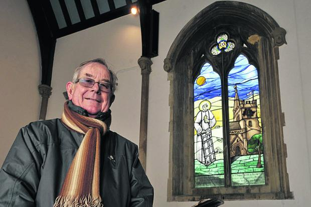 David Frostick, feoffee of St Lawrence Chapel, Warminster, with the new stained glass window Photo: Glenn Phillips (48098)