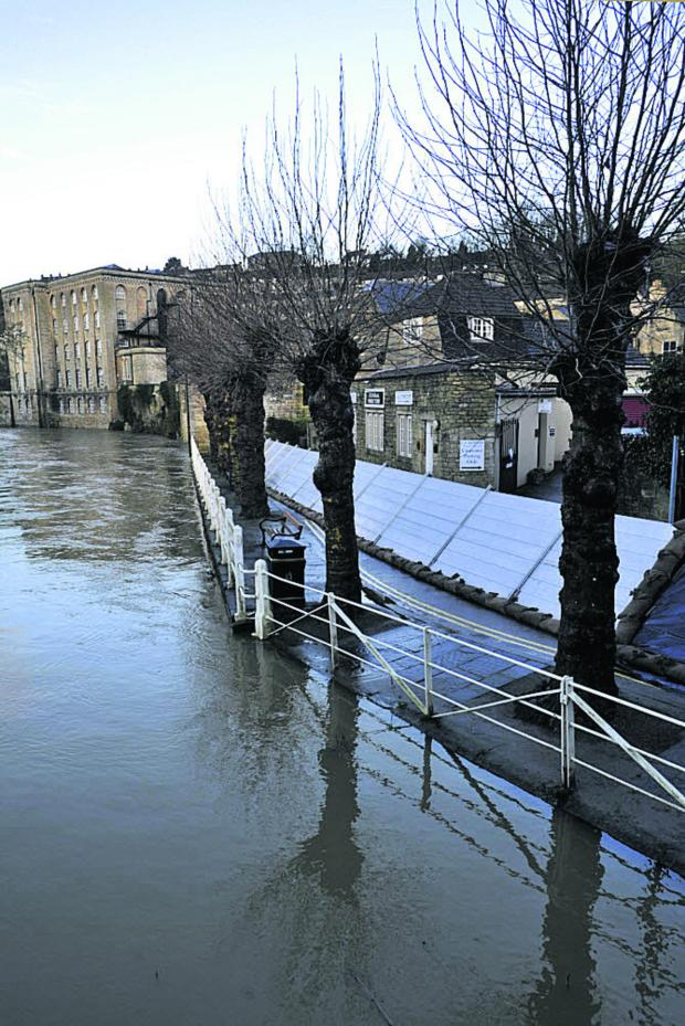 Wiltshire Times: Temporary flood barriers in place at The Bullpit, Bradford on Avon, this morning