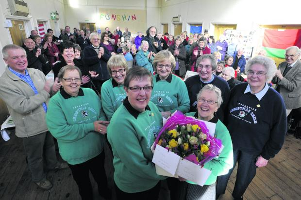 Wiltshire Times: Operation Christmas Child's Hilary McFall, centre left, says farewell to colleagues at Melksham Baptist Church on Saturday                                                                           Photo: Glenn Phillips (48101)