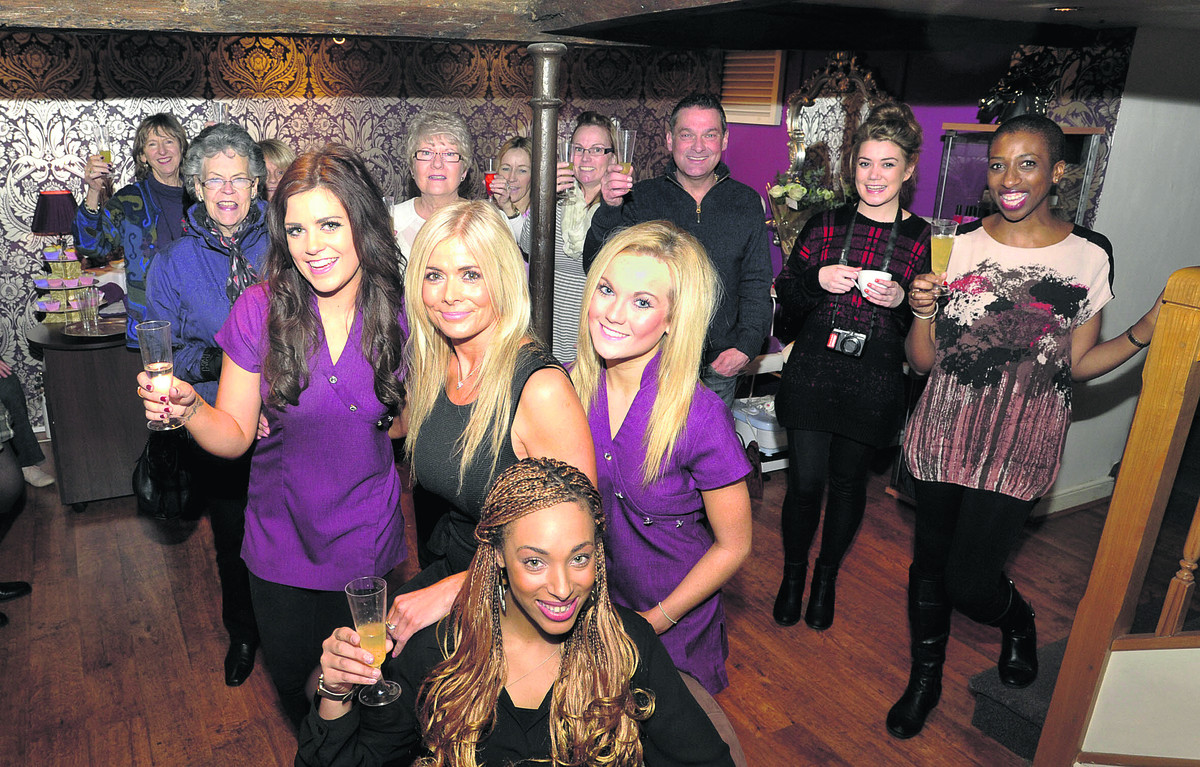 Courtney Wicheard, front,  Tracey Tyler, Danielle Tyler, left, and Leanna Clarke, front  right, of The Beauty Spot with family, friends and customers at their launch  party on Saturday