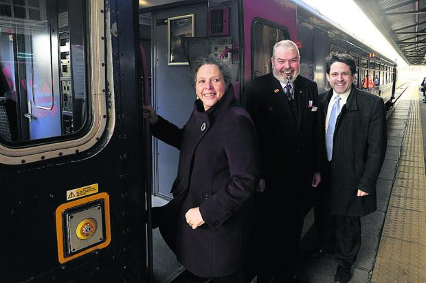 Baroness Kramer boards the train at Westbury, alongside train guard Simon Loftus and Chippenham Constituency MP Duncan Hames