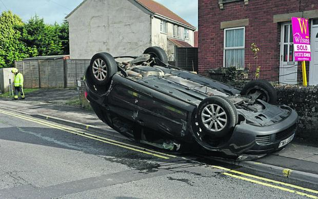The car on its roof in Westbury