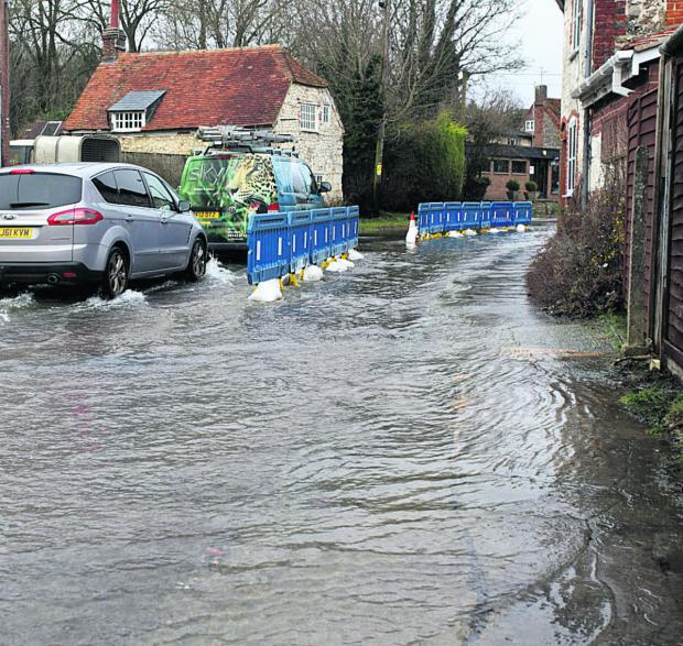 Wiltshire Times: Flooding in Lottage Street, Aldbourne, this morning