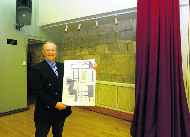 Coun David Powell, leader of Chippenham Town Council, with plans for the Neeld Hall