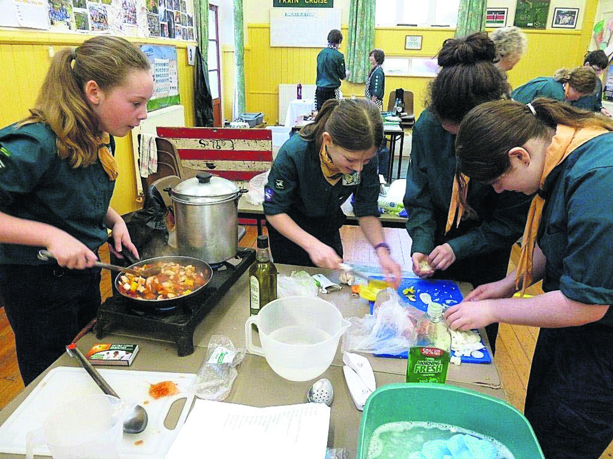 West Wilts District Scouts working hard on their creation for the cooking competition