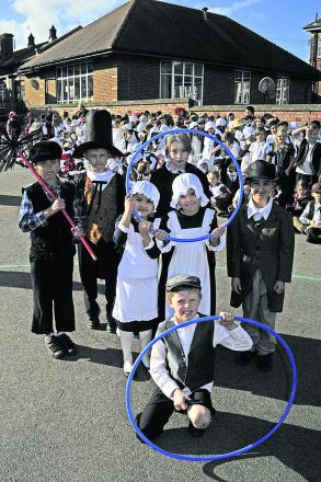 Pupils play in their period costume for a Victorian day
