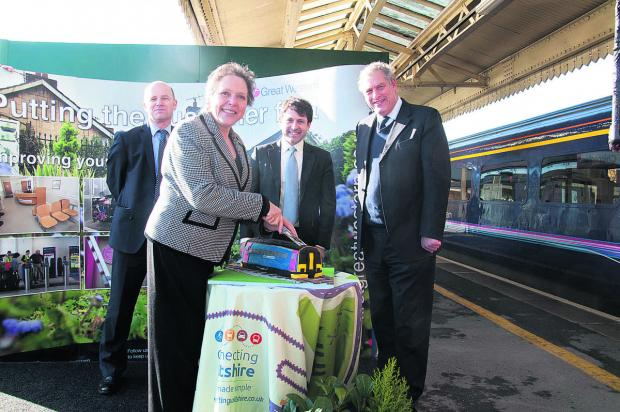 Baroness Kramer cuts a cake at Chippenham train station to officially launch the Transwilts service with, from left, Matthew Golton, project and planning director with First Great Western, Chippenham MP Duncan Hames and John Thomson, deputy leader of Wilt