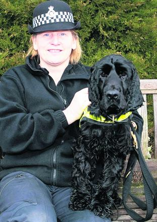 PC Marie Poole with Wiltshire Police drug sniffer dog Griffin