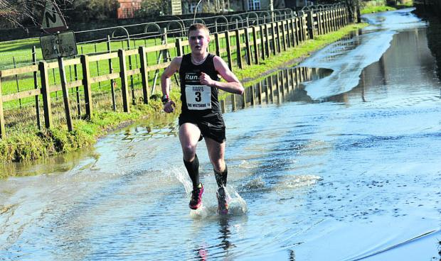 Winner Simon Nott splashes his way through Reybridge