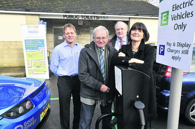 Shay Parsons of Climate Friendly Bradford on Avon with, from left, Kevin Sharpe of Zero Carbon World, Cllr Horace Prickett and Cllr Richard Gamble at the car charging point in Bradford station car park 	Photo: Glenn Phillips (49157)