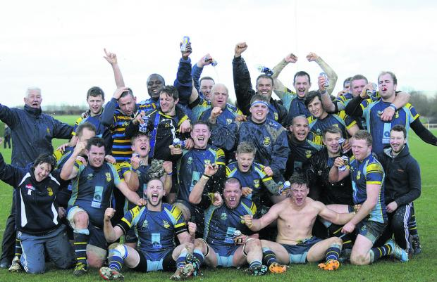 Triumphant Trowbridge's players, coaches and officials start the celebrations after last Saturday's 20-15 victory over Devon side Ivybridge – which left them one match from a final at Twickenham in May