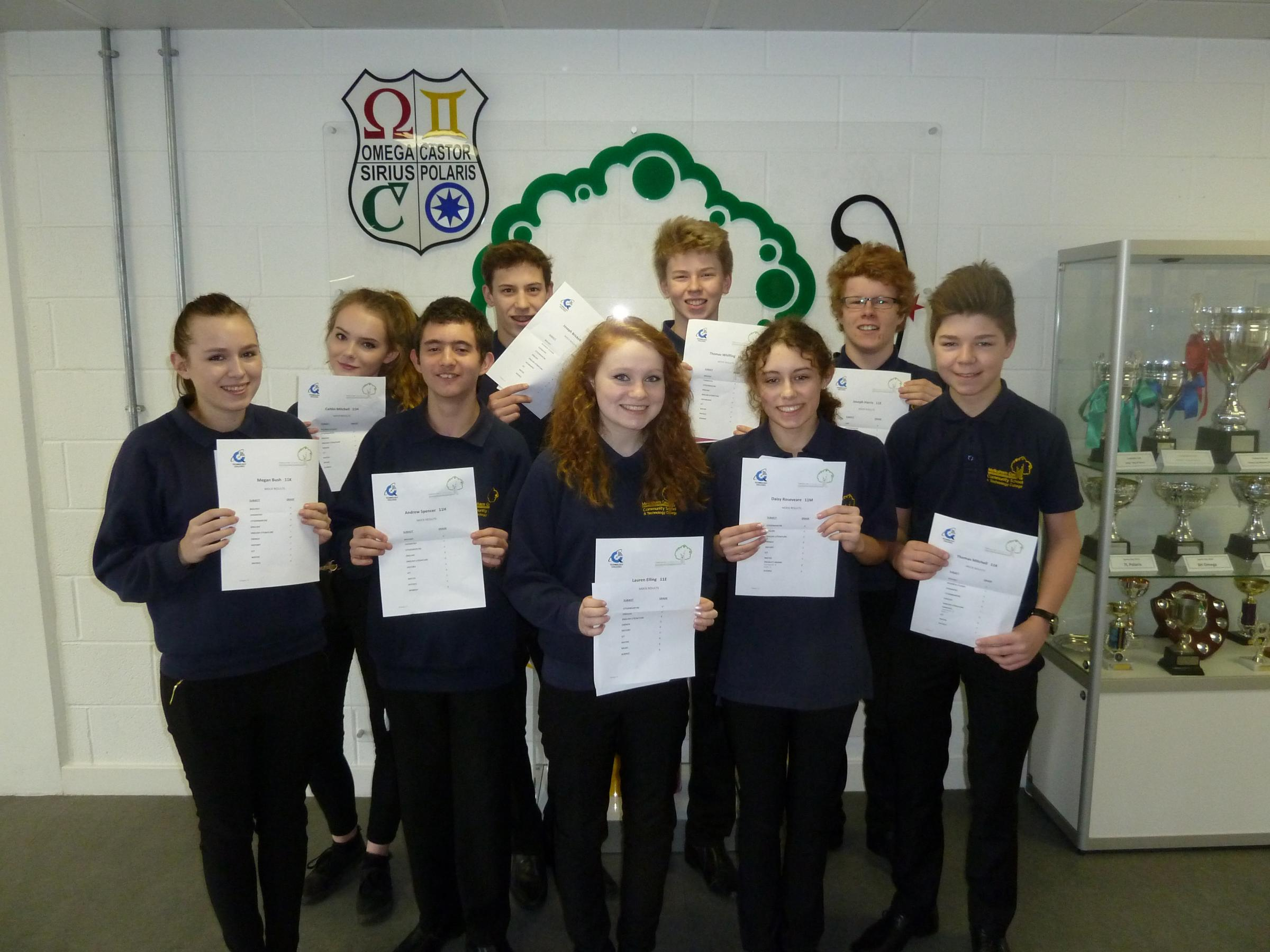 The school's top 10 achievers celebrate their mock results: Tom Whiffing, Joe Harris, Megan Bush, Daisey Roseveare, Caitlin Mitchell, Andrew Spencer, Sam Day, Lauren Elling, Tom Mitchell and Jojo Brickell